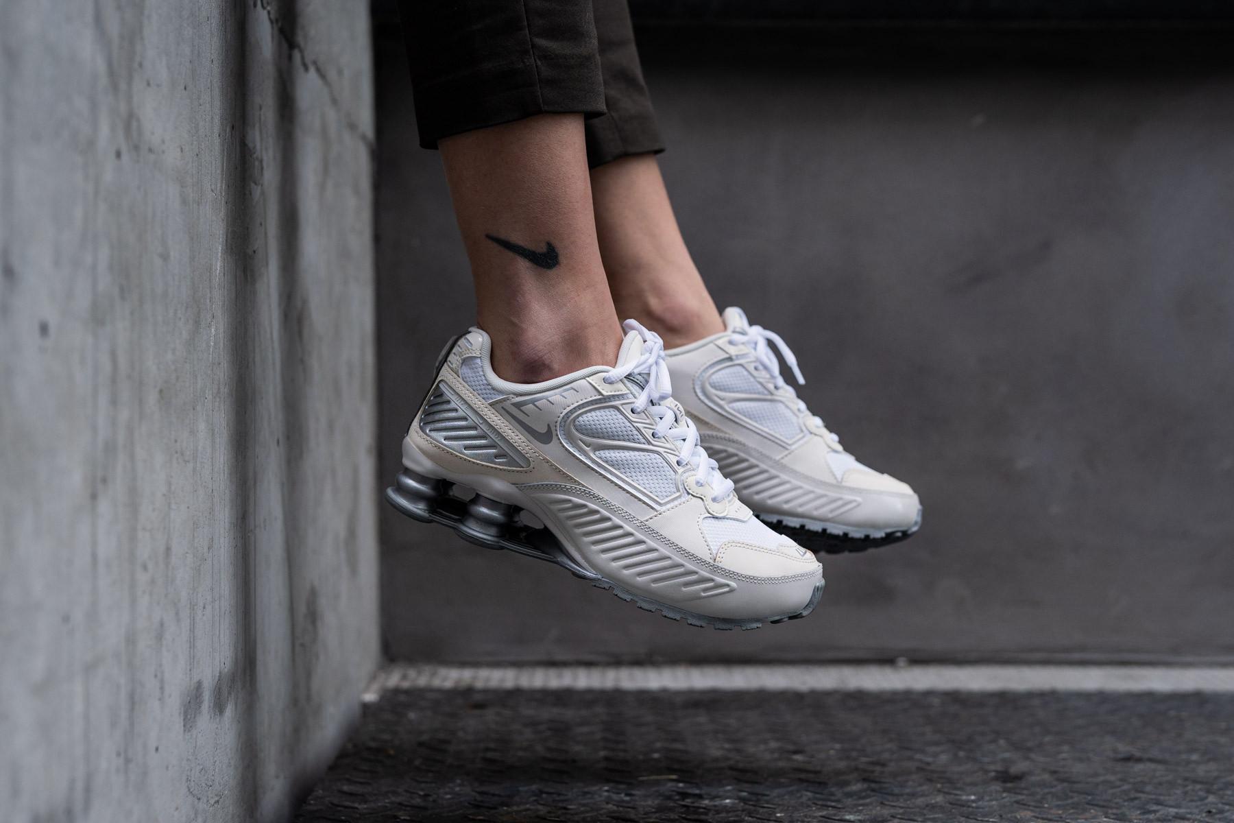 White Nike Shox Shoes.